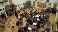 Orchestral musicians recording at London's iconic Abbey Road Studios made famous by the likes of the Beatles NO