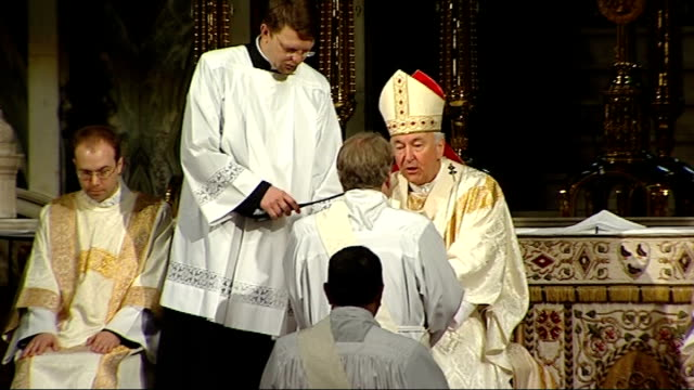 Ordination of three exAnglican bishops into Catholic church BV Kneeling bishops GVs bishops John Broadhurst Andrew Burnham and Keith Newton being...