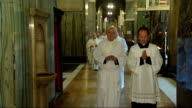 Ordination of three exAnglican bishops into Catholic church ENGLAND London Westminster Cathedral INT GVs Procession of Catholic priests in cathedral...