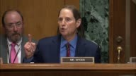 Oregon Senator Ron Wyden reads prepared remarks at a hearing of the Senate Finance Committee on a health care block grant bill cosponsored by...