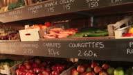 organic shop shelves of fruit and vegetables