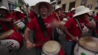 Organisers of the AfroAmerican festivities commemorating Candombe Day in Uruguay pay tribute to Nelson Mandela as hundreds of drums are played across...