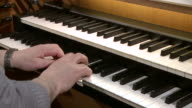 MS Organist at church organ playing / Saarburg, Rhineland-Palatinate, Germany