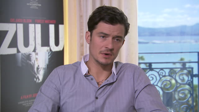 INTERVIEW Orlando Bloom on filming in Capetown South Africe at 'Zulu' Interviews on May 25 2013 in Cannes France