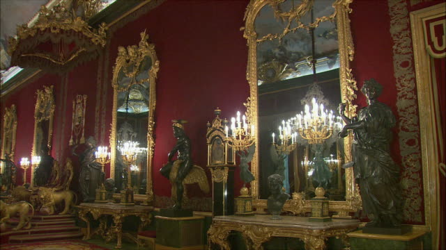 WS PAN Ornate furniture and tourists in hall of Royal Palace, Madrid, Spain