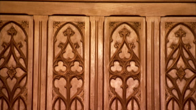 Ornate wood carvings decorate a panel in an art deco former London cinema. Available in HD.