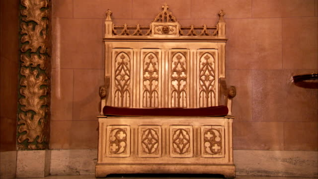 Ornate wood carvings decorate a throne in an art deco former London cinema. Available in HD.