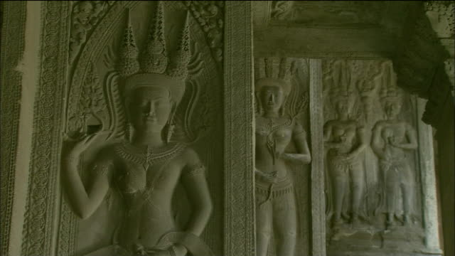 Ornately-carved relief of goddess at Angkor Wat, Cambodia