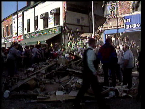 close up LIB Rescuers clearing up following IRA bomb