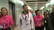 Oscar Pistorius walks through Heathrow after arriving for the London olympics He then talks to a TV crew in the terminal 5 arrivals area