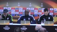 Osmanlispor's head coach Mustafa Resit Akcay and forward Pierre Webo attend a press conference the day before the UEFA Europa League Round of 32...