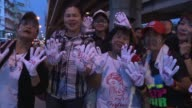 Ousted premier Yingluck Shinawatra's supporters rally in the streets ahead of Thailand's top court's decision on whether the former leader is guilty...