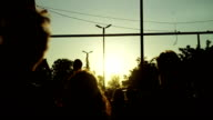 Outdoor party during twilight. Silhouettes of walking people