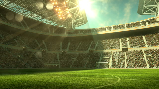 Outdoor soccer stadium on sunlight