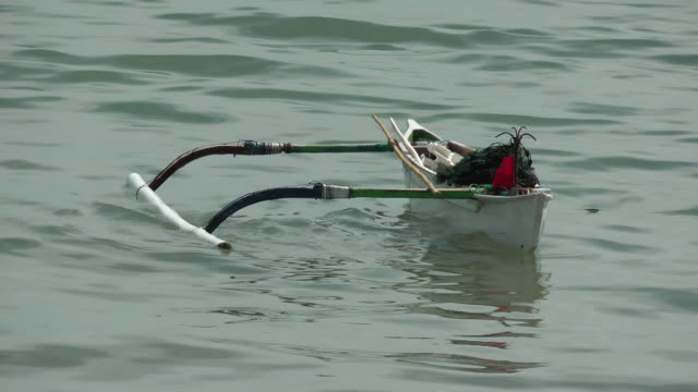 Outrigger canoe all alone