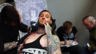 Over 300 tattoo artists from around the world are showcasing their body art in 26 halls at the convention which also features live music and tattoo...