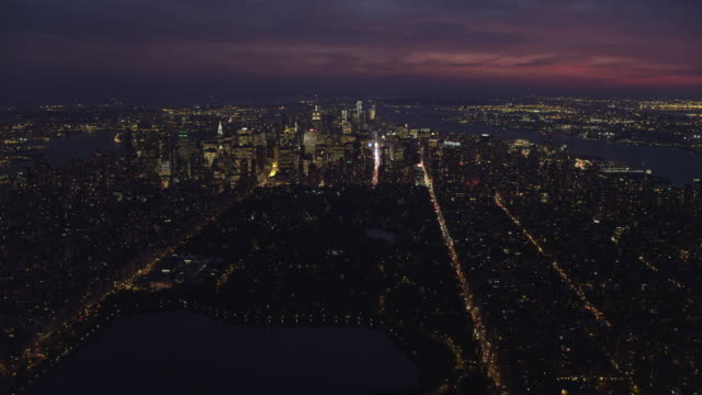 Over Central Park at dusk, looking toward Times Square and Lower Manhattan; Hudson River and East River in view on right and left respectively. Shot in November 2011.