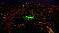 AERIAL Over freeways and Staples Center towards downtown Los Angeles at night / California