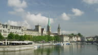 PAN over Limmat river, Zurich historic city center; landmarks left to right as they come into view: Fraumünster/ St. Peter's Churc / Grossmünster