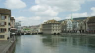 PAN over Limmat river, Zurich historic city center / old town hall in center (built onto river)
