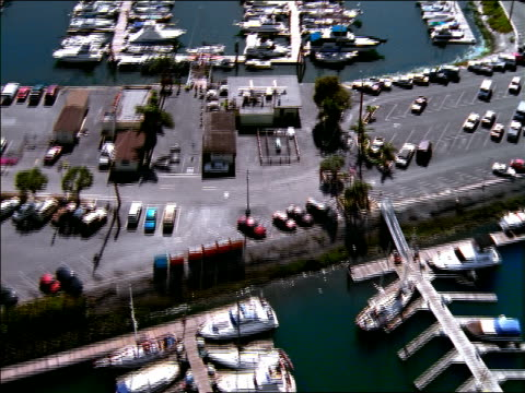 AERIAL over marina + parking lot / Long Beach, California