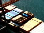 AERIAL over shipping containers on freighter docked at port / Long Beach, California