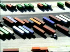 AERIAL over shipping containers parked in yard of San Pedro harbor / California