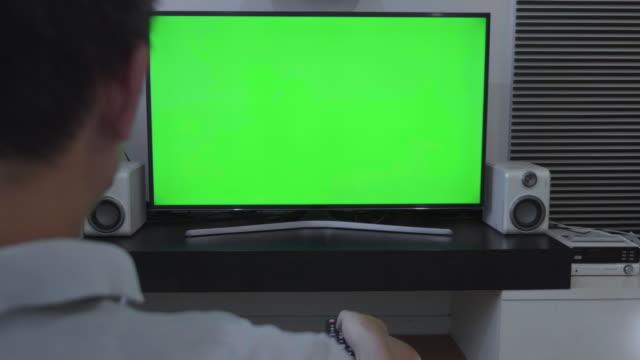 Over shoulder shot of green screen TV,Dolly shot