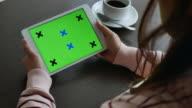 Over shoulder shot of Holding Using digital tablet, Green screen