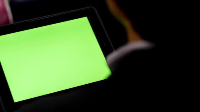 over shoulder shot of using tablet green screen