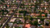 AERIAL POV over suburban development and houses / California