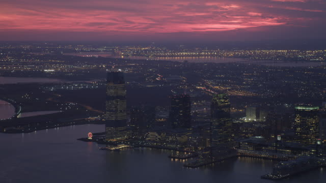 Over the Hudson at dusk, looking toward Jersey City skyline. Shot in 2011.