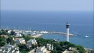 Over the Top Of Faro De Torredembarra Lighthouse  - Aerial View - Catalonia, Tarragona, Torredembarra, Spain