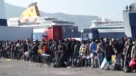 Over three thousand migrants leave the island of Lesbos in one morning on ferries bound for Athens