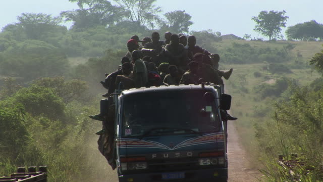 MS Overcrowded truck on dirt road, Congo
