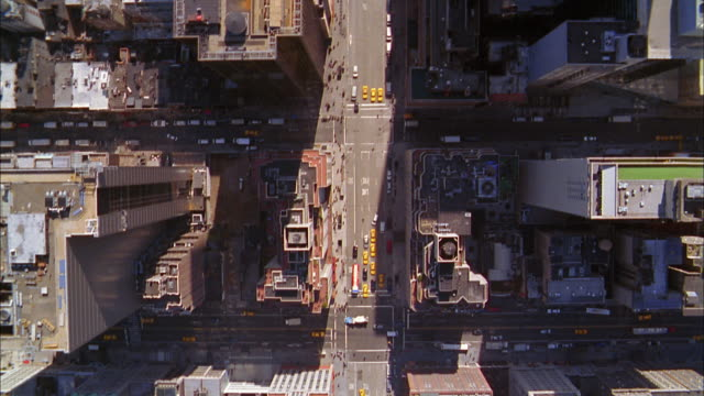 Overhead aerial Manhattan building rooftops and street traffic