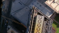 Overhead aerial over Manhattan building rooftops and streets