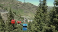 WS HA POV Overhead cable cars going up mountain / Tian Chi, Xinjiang, China