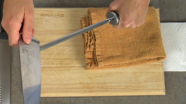 overhead how to sharpen a kitchen knife stock footage