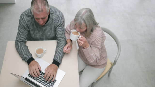 Overhead shot of a senior couple using a laptop together