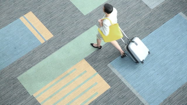 Overhead shot of people walking with luggage