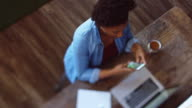 Overhead Shot of Woman Working at Desk - Tilt Shift