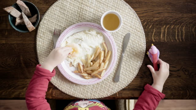 Overhead view child eating