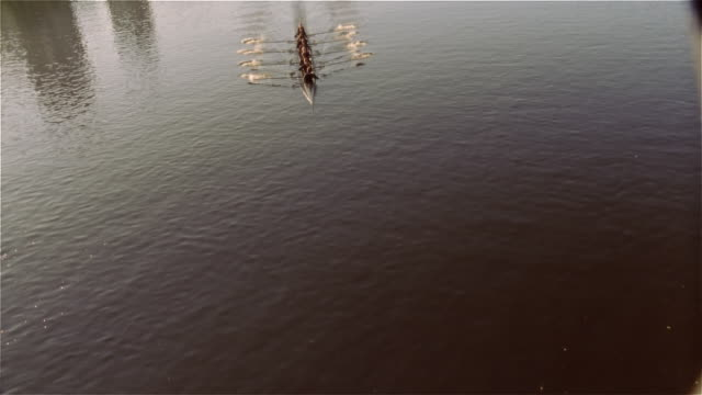 Overhead view crew team rowing racing shell on Charles River