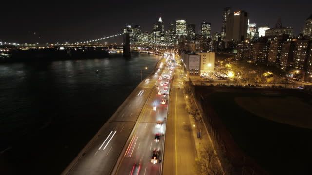 WS T/L Overhead view of east river and brooklyn bridge / New York, United States