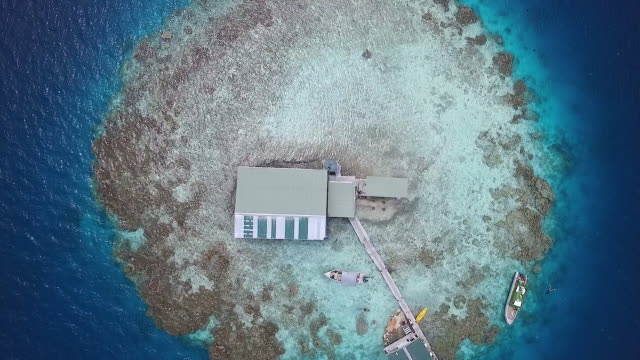 Overhead view rising over Black Pearl Farm in Manihiki Lagoon