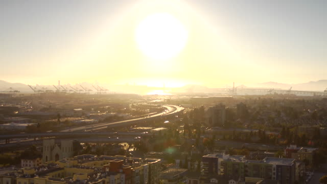 Overlooking city RAPID MOTION Vehicles driving on highway below sun moving lower in sky BG