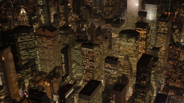 overlooking manhattan midtown district at night. high rise buildings