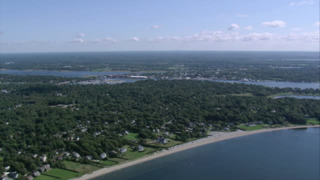 AERIAL Overview of coastal landscape leading to and featuring the town of Warren / Rhode Island, United States