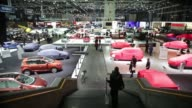 overview of floor plan at the 82nd Geneva International Motor Show / WS of cars with slip covers on / preparations of exhibits before public views...